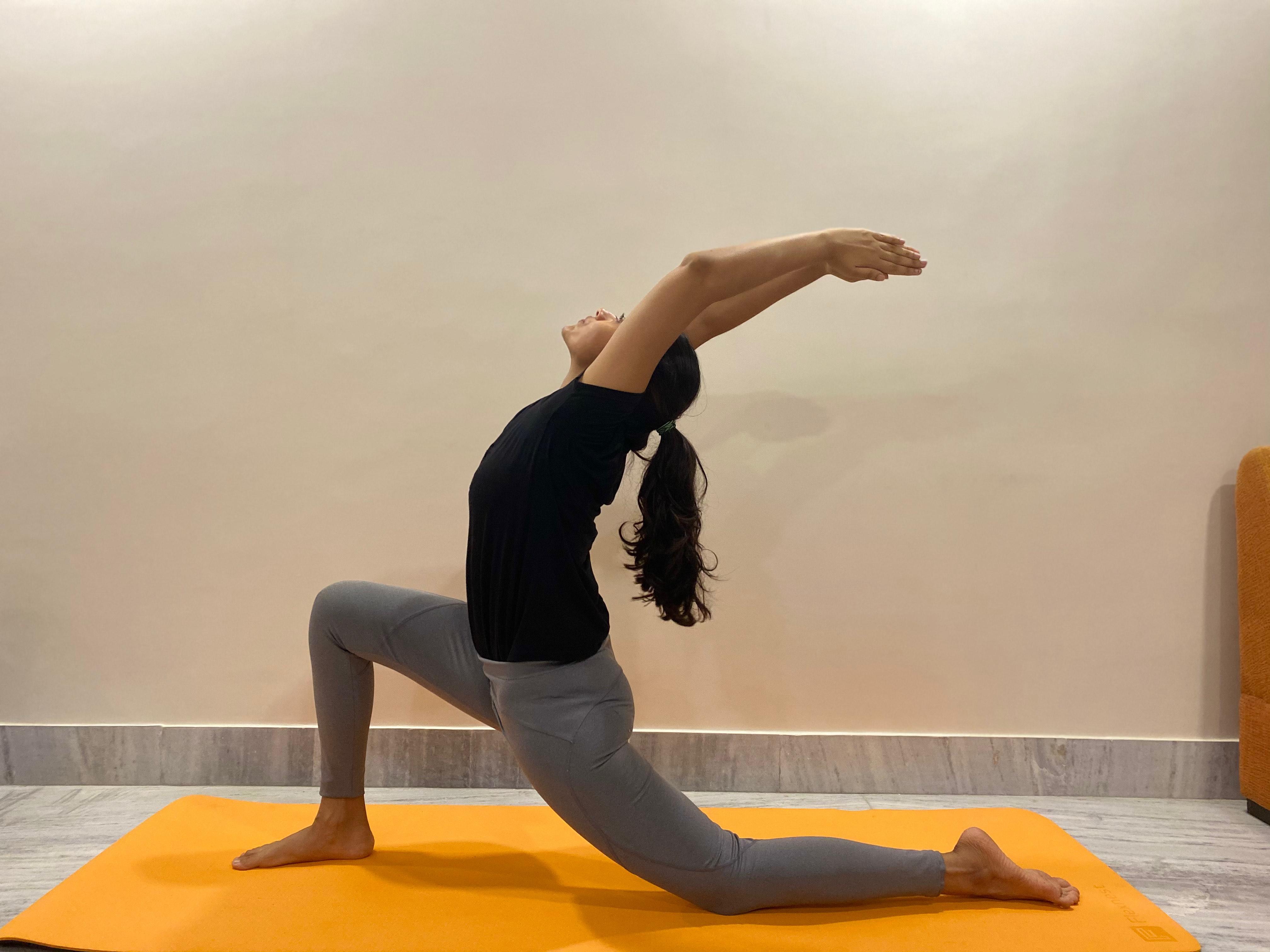 Crescent Lunge (Anjaneyasana) Yoga pose for PMS