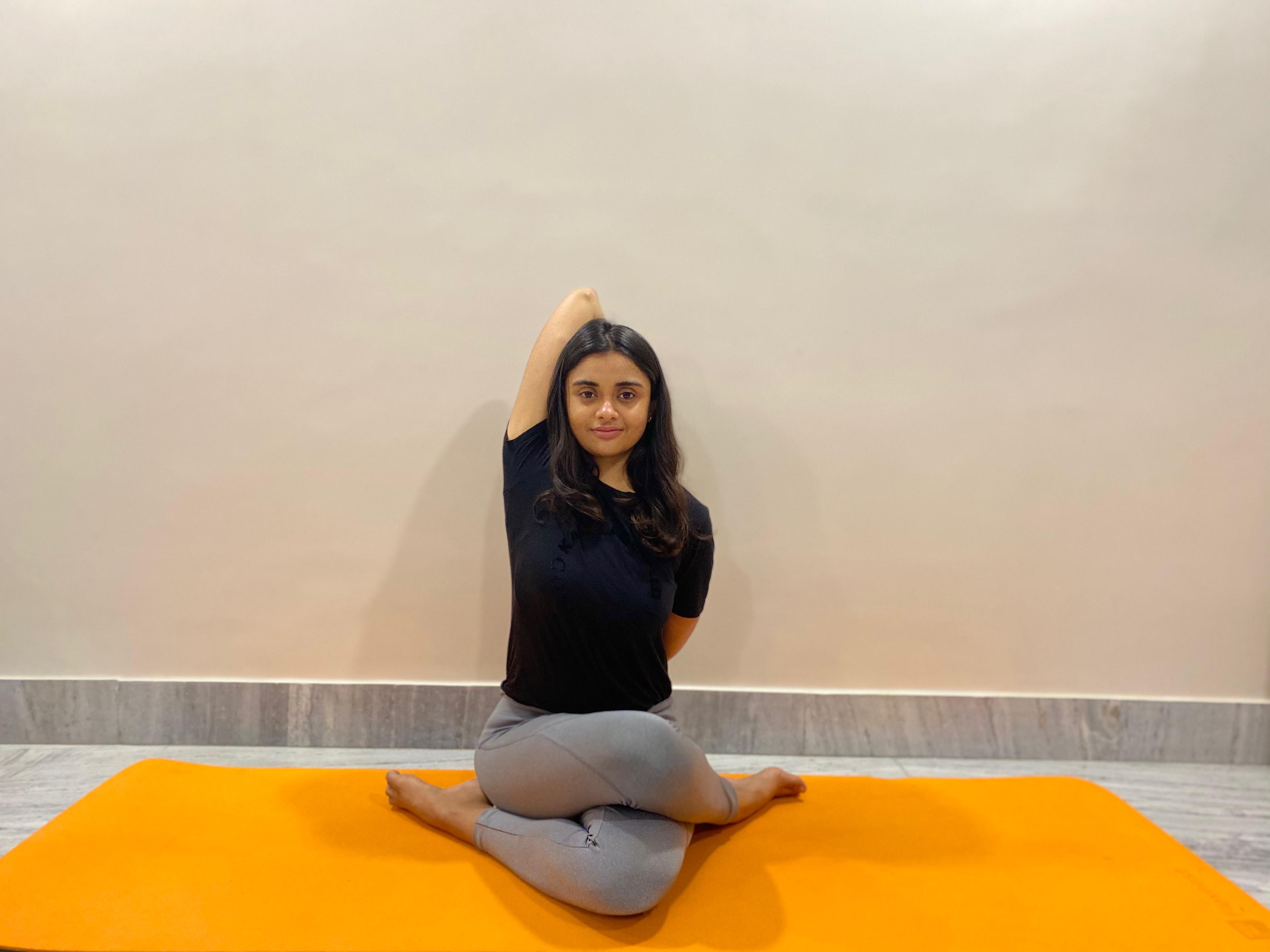 Cow face pose (Gomukhasana) Yoga Pose for PMS