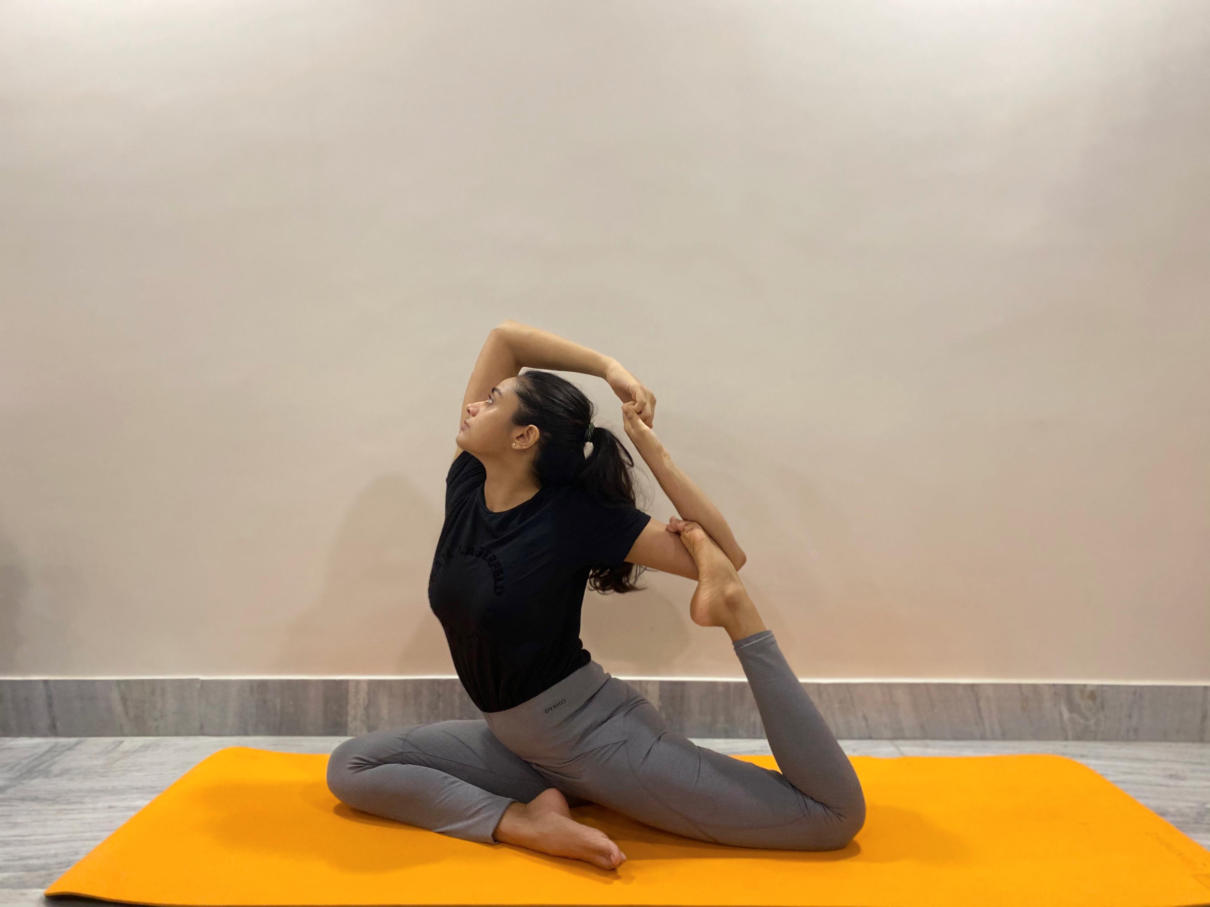 Eka Pada Rajakapotasana (One-legged king pigeon pose) Yoga Pose for PMS